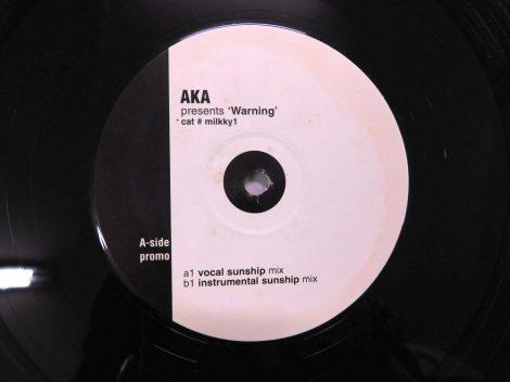 """AKA Presents 'Warning' - cat # milkky1 12"""" (VG+/VG) UK, 2000"""